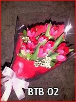 Hand buket tulip merah